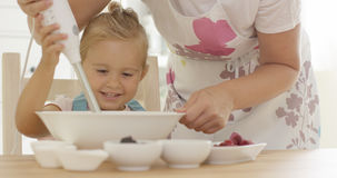 Cute happy little girl helping with the baking Stock Photos