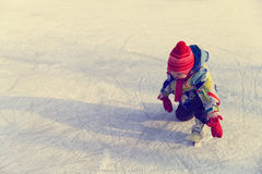 Cute happy little girl learn to skate in winter Stock Image