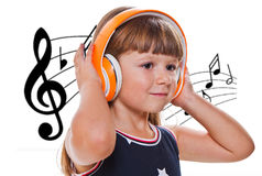 cute happy little girl listening music with headphones Stock Photography