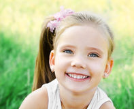 Cute happy little girl on the meadow Stock Image