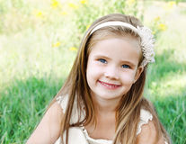 Cute happy little girl on the meadow Stock Photography