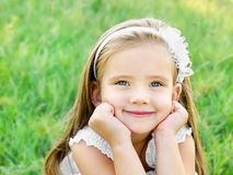 Cute happy little girl on the meadow Royalty Free Stock Photos