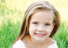 Cute happy little girl on the meadow Royalty Free Stock Images
