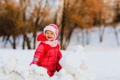 Cute happy little girl play in winter Stock Images