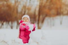 Cute happy little girl play in winter Stock Photo