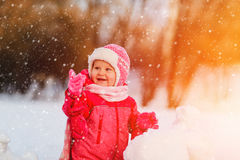 Cute happy little girl play in winter snow Royalty Free Stock Photography