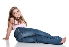 Cute happy little girl sitting on white background Stock Image