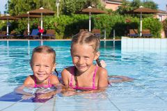 Cute happy little girls having fun in the swimming Royalty Free Stock Images