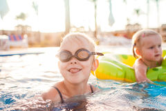 Cute happy little girls having fun in swimming pool Royalty Free Stock Photo