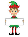 Cute and happy looking christmas elf holding a bla Stock Photo