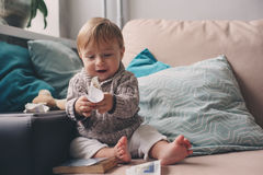 Cute happy 11 month baby boy playing at home, lifestyle capture in cozy interior stock photo