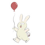 Cute happy rabbit playing with helium balloon. Royalty Free Stock Photography