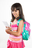 Cute and happy school girl holding a tablet Royalty Free Stock Photos