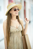 Cute happy shopper woman wearing hat and sunglasses Royalty Free Stock Images