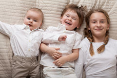 Cute happy siblings expressing happiness. Stock Photo