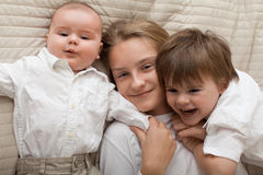 Cute happy siblings expressing happiness. Royalty Free Stock Images
