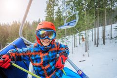 Cute skier boy in a winter ski resort. royalty free stock photos