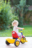 Cute happy smiling baby girl riding her first bicycle Royalty Free Stock Photo