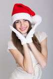 Cute happy teenage girl posing for Christmas Stock Photos