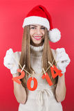 Cute happy teenage Santa girl holding new year numbers decoration Royalty Free Stock Images