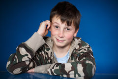 Cute happy teenager boy. On a blue background Stock Image
