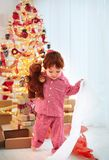 Cute happy toddler boy in pajamas has got his present on christmas. Cute happy toddler baby boy in pajamas has got his present on christmas royalty free stock photo