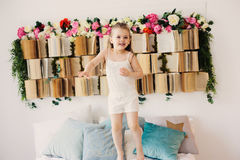 Free Cute Happy Toddler Girl Sitting On Bed In Pajama. Child Playing At Home Stock Image - 97120031