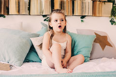 Free Cute Happy Toddler Girl Sitting On Bed In Pajama. Child Playing At Home Royalty Free Stock Photo - 97120125