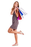 Cute happy woman holding her shopping bags Stock Image