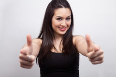 Cute happy woman pointing or showing Stock Images