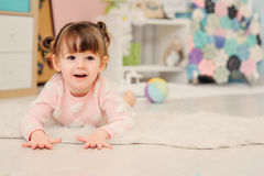 Cute happy 2 years old baby girl playing with toys at home Stock Photos