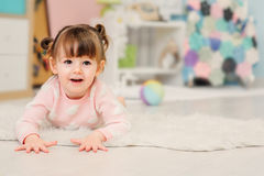 Cute happy 2 years old baby girl playing with toys at home Royalty Free Stock Photo