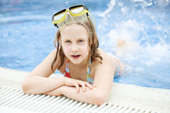 Cute happy young girl child swimming Royalty Free Stock Images