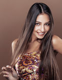 Cute happy young indian real woman in studio close up smiling, f Stock Image