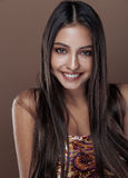 Cute happy young indian woman in studio close up smiling, fashion mulatto beauty Royalty Free Stock Photos