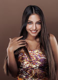 Cute happy young indian woman in studio close up smiling, fashion mulatto beauty. Cute happy young indian woman in studio close up smiling gesturing, fashion Royalty Free Stock Photo