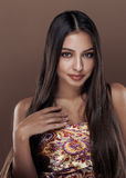 Cute happy young indian woman in studio close up Royalty Free Stock Photography
