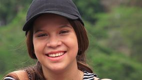 Cute Happy Young Person. Young attractive teen Colombia girl royalty free stock image