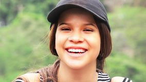 Cute Happy Young Person. A young hispanic teen girl stock photo