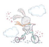 Cute hare on a bicycle. Bunny in the vector. Sweetheart card. Royalty Free Stock Images