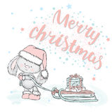 Cute hare carries gifts on sledge. Christmas card with a rabbit. Stock Images