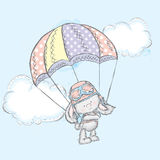 Cute hare flies on a parachute.  Charming Bunny. Stock Photos