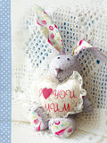 Cute hare. Happy Mother's Day bunnie holding heart with the inscription I love mum. Greeting card for Mother's day.  Royalty Free Stock Photography