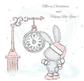 Cute hare under the clock.  Stock Photography