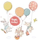 Cute hares in balloons royalty free stock photos