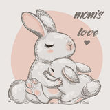 Cute hares - mom and kid Stock Photo