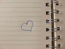 Cute heart drawn in notebook Royalty Free Stock Images