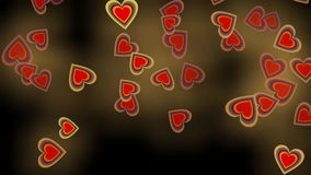 Cute heart particles wild flying in fire on black background, seamless video animation. FullHD video 1920x1080 stock footage