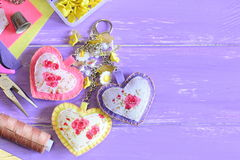 Cute hearts keychain with flowers beads. Hand felt and fabric keychain on bag or backpack. Summer accessorize for women or girls Stock Images