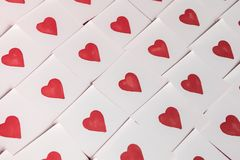 Love notes. Background for design with red hearts Background with red hearts. Pattern. Cute hearts love drawing pattern Abstract empty sticky note with heart royalty free stock image